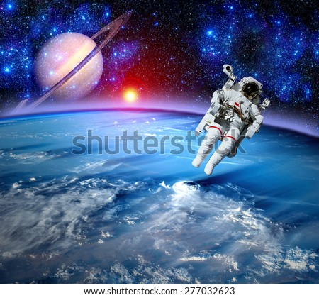 Astronaut spaceman outer space gravity planet earth sun. Elements of this image furnished by NASA.