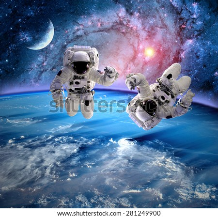 Astronaut spaceman outer space moon planet solar system universe. Elements of this image furnished by NASA. - stock photo