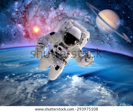 Astronaut spaceman outer space saturn planet earth sun. Elements of this image furnished by NASA. - stock photo