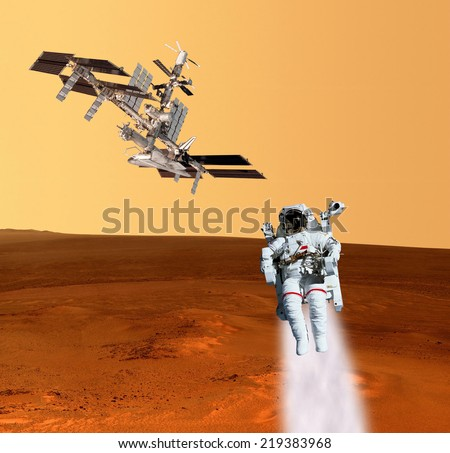 Astronaut spaceman planet Mars spaceship. Elements of this image furnished by NASA. - stock photo