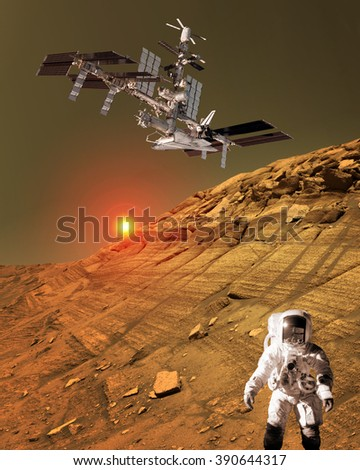 Astronaut spaceman planet Mars surface martian colony space landscape. Elements of this image furnished by NASA.
