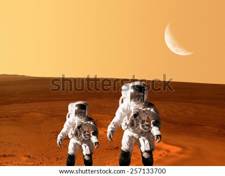 Astronaut spaceman planet Mars surface space people. Elements of this image furnished by NASA. - stock photo