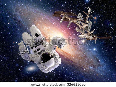 Astronaut spaceman sci fi outer space shuttle station spaceship. Elements of this image furnished by NASA.