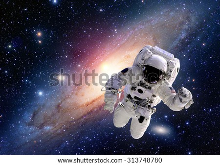 Astronaut spaceman suit outer space solar system people universe. Elements of this image furnished by NASA. - stock photo