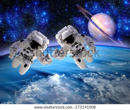 Astronaut spaceman team work space teamwork hands people. Elements of this image furnished by NASA. - stock photo