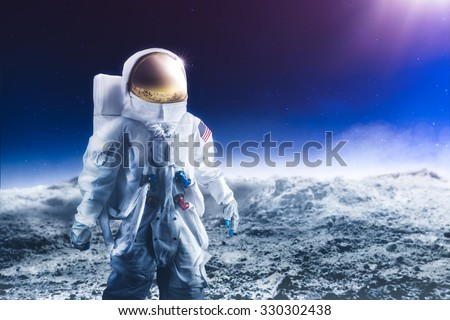 """Astronaut standing on the moon """"Elements of this image were NOT furnished by NASA"""" - stock photo"""