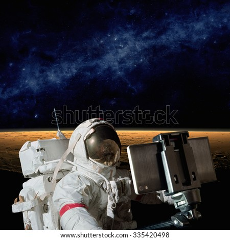 Astronaut taking selfie photo on planet Mars, mission to Mars. Elements of this image furnished by NASA nasa.gov - stock photo