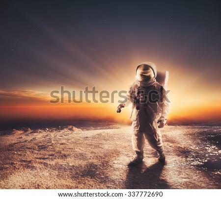 Astronaut walking on an unexplored planet - stock photo