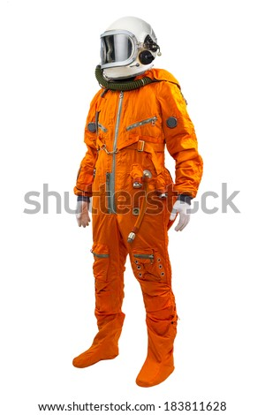 Astronaut wearing space suit standing against white background. - stock photo