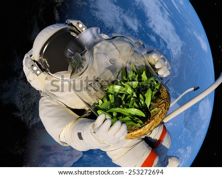 "Astronaut with seedlings on the background of the planet.""Elemen ts of this image furnished by NASA"" - stock photo"
