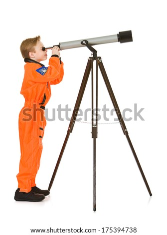 Astronaut: Young Science Boy Looks Through Telescope - stock photo