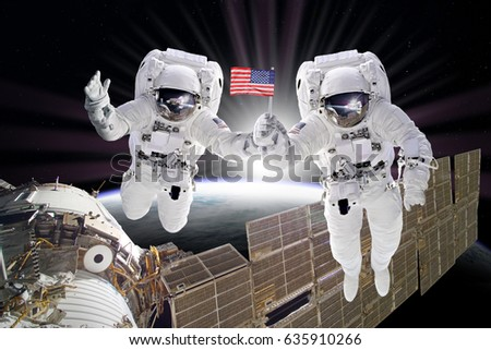 stock-photo-astronauts-floats-on-space-s