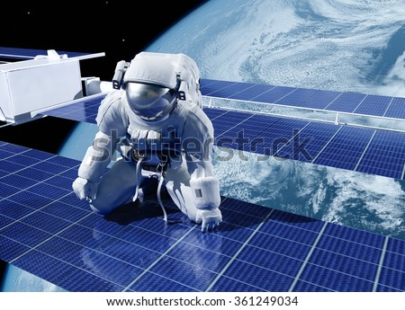"Astronauts in space around the solar battarei.""Elemen ts of this image furnished by NASA"" - stock photo"
