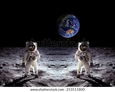 Astronauts spaceman moon landing Earth view. Elements of this image furnished by NASA. - stock photo