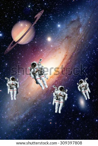 Astronauts spaceman outer space solar system saturn planet universe. Elements of this image furnished by NASA. - stock photo