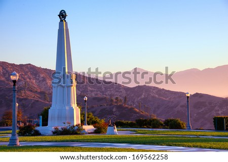 Astronomers Monument in Griffith Park at sunrise, Griffith Observatory, Los Angeles, California, USA - stock photo