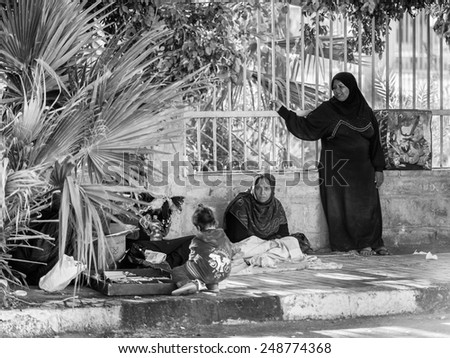 ASWAN, EGYPT - DEC 2, 2014: Unidentified Egyptian women in the street. 90% of Egyptian people are Muslim