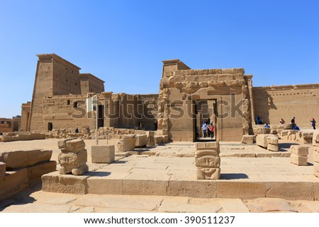ASWAN, EGYPT - FEBRUARY 1, 2016: Tourists visiting the Graeco-Roman Temple of Philae  dedicated to the cult of Isis in Egypt