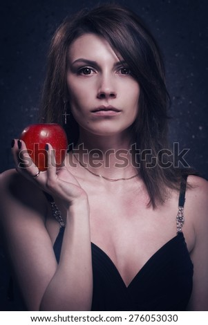 Asylum. Lonely mad woman with red apple. Low key. - stock photo