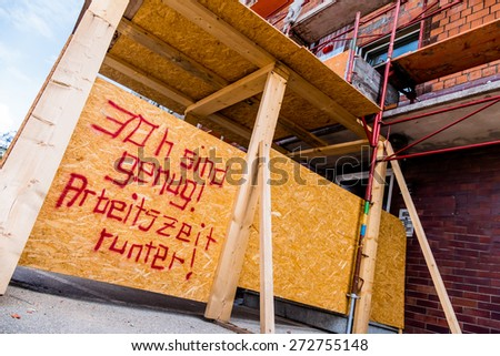 at a construction site is a sign of aufschrifft: thirty hours are enough. symbolic photo for shorter working hours - stock photo
