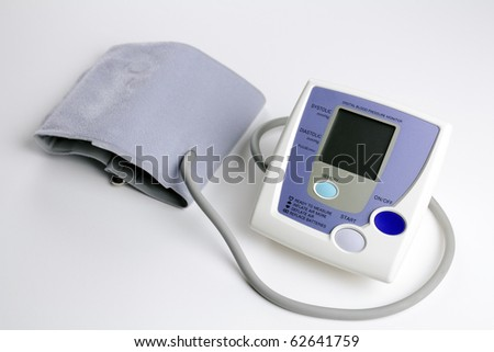 At home digital blood pressure monitor on white background to measure high blood pressure, low blood pressure and pulse. - stock photo