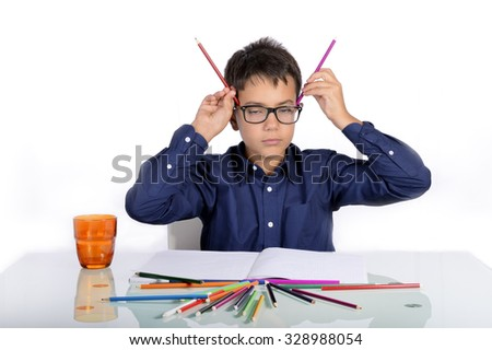 At home it's time to do homework. Grimaces, sadness and difficulties but also jokes. The boy came back to school. - stock photo