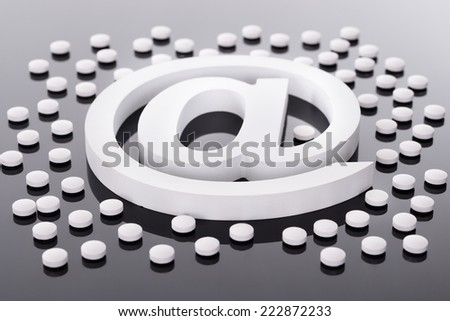 At Internet Symbol and Medicine Pills on Black