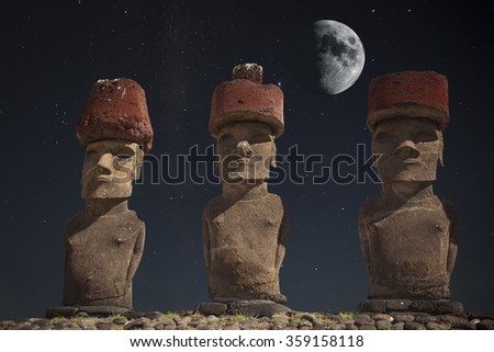 At night, under the light of stars. Moais at Ahu Tongariki (Easter island, Chile) - stock photo