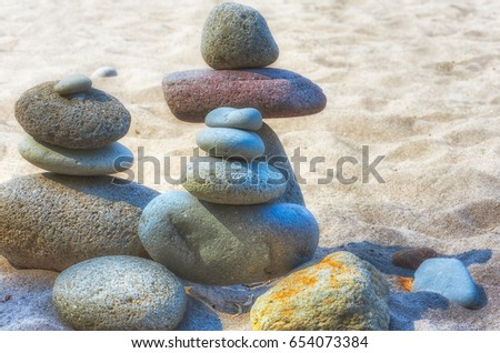 At Oxbow Park, along the Sandy River, has a beach where rocks are staked by anyone who visits the area creating a village of stacked rocks.