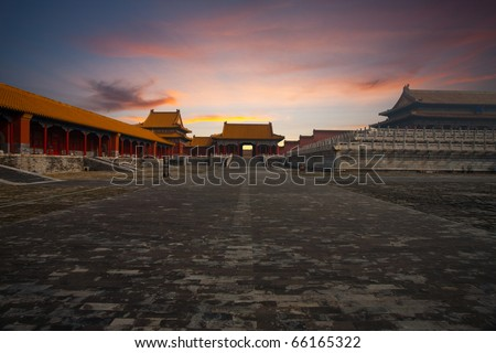 At sunrise, a side gate is seen next to the Hall of Supreme Harmony at the Forbidden City, Imperial Palace complex in Beijing, China - stock photo