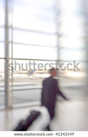 At the airport - blurred pilot - stock photo