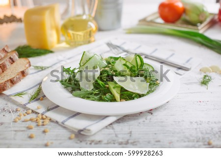 At The Center Of The Frame White Plate With A Salad Of Arugula Rocket