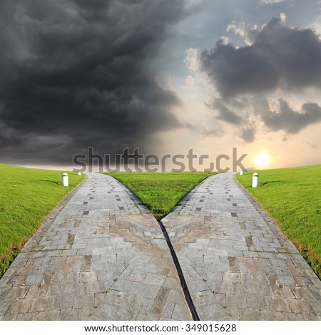 At the crossroad of a stone road leading to nightfall and sunrise.  - stock photo