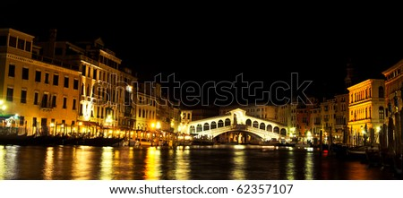 At the evening around the Grand Canal, The Rialto bridge under evening lights. - stock photo