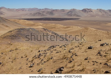 Atacama, Chile. Installation of solar panels in the middle of dunes of Atacama desert, the driest desert in the world.