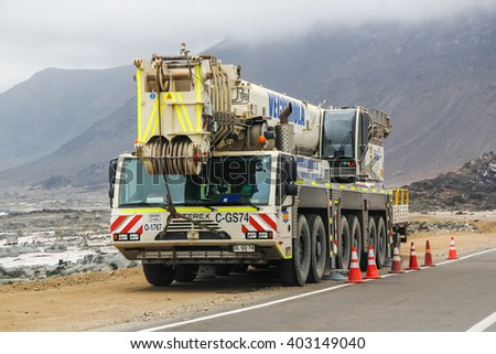 ATACAMA, CHILE - NOVEMBER 14, 2015: Heavy mobile crane Terex at the interurban road. - stock photo