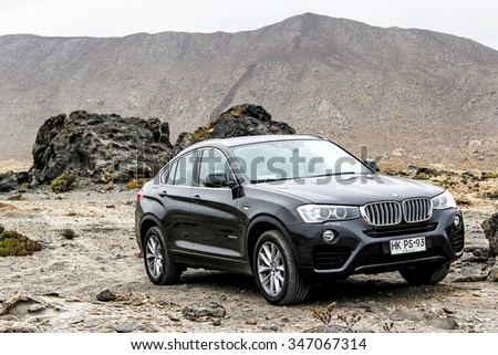 ATACAMA, CHILE - NOVEMBER 14, 2015: New black crossover BMW F26 X4 at the stone desert. - stock photo