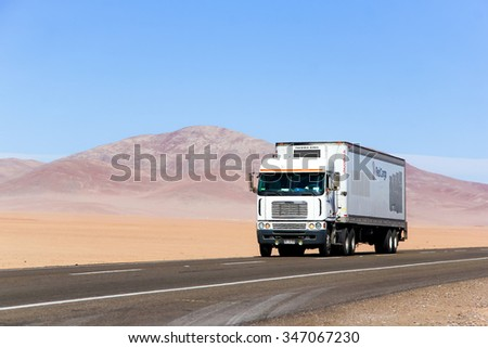 ATACAMA, CHILE - NOVEMBER 14, 2015: Semi-trailer truck Freightliner Argosy at the Pan-American Highway. - stock photo