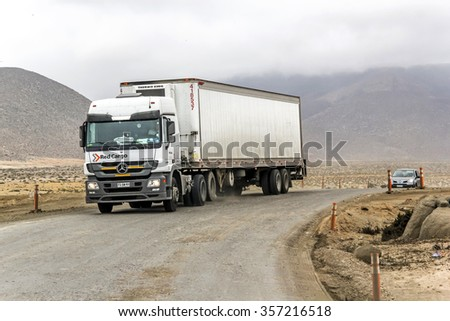 ATACAMA, CHILE - NOVEMBER 14, 2015: Semi-trailer truck Mercedes-Benz Actros at the gravel interurban freeway through the Atacama desert. - stock photo