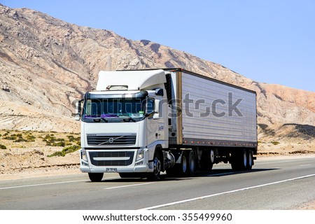 ATACAMA, CHILE - NOVEMBER 14, 2015: Semi-trailer truck Volvo FH12 at the interurban freeway through the Atacama desert. - stock photo