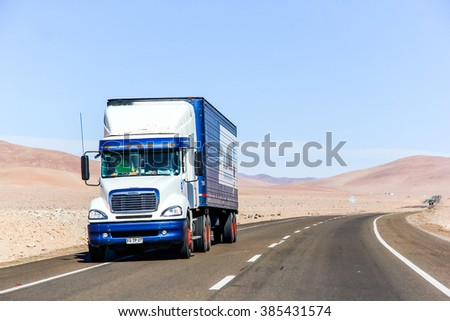 ATACAMA, CHILE - NOVEMBER 14, 2015: White semi-trailer truck Freightliner Columbia at the interurban freeway throught the Atacama Desert (Ruta del Desierto).