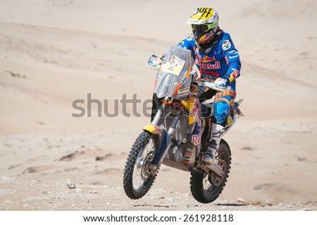Atacama Desert, Copiapa, CHILE. January 07, 2015. Bike rider Spanish pilot JORDI VILADOMS race on the sand dunes of the Atacama Desert in Chile during the Chilean stage of Dakar Rally 2015. - stock photo