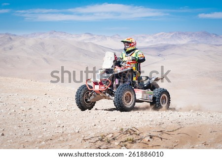 Atacama Desert, Copiapo, CHILE. January 07, 2015. Bike rider WALTER NOSIGLIA (BOL) race on the sand dunes of the Atacama Desert in Chile during the Chilean stage of Dakar Rally 2015.   - stock photo