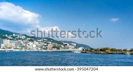 ATAMI, JAPAN - OCTOBER 27, 2012 : View on Atami city from Sagami bay, Kanagawa prefecture, Japan