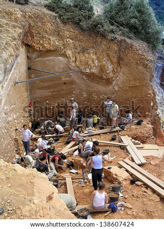 ATAPUERCA, SPAIN - AUGUST 5: Some researchers work in Atapuerca site, where fossils and stone tools of the earliest known humans in West Europe have been found, on August 5, 2005, in Atapuerca, Spain.