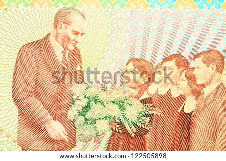 Ataturk with child symbolizes the revolution of new Turkish alphabet. Close up of old Turkish banknote (100,000 TL) - stock photo