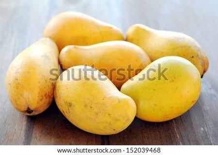 ataulfo mango on table  - stock photo