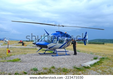 ATHABASCA GLACIER, ALBERTA - AUGUST 1 - Helicopter Ride at Athabasca Glacier in Alberta, Canada on August 01, 2014. Thousands of people come every year to do Ice Explorer Ride at the Glacier - stock photo