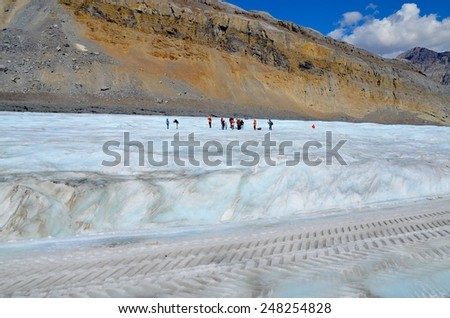 ATHABASCA GLACIER, ALBERTA - AUGUST 1 - Ice Explorer Ride at Athabasca Glacier in Alberta, Canada on August 01, 2014. Thousands of people come every year to do Ice Explorer Ride at the Glacier - stock photo