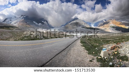 Athabasca Glacier and Columbia Ice Fields, Banff National Park, Alberta, Canada Located about an 1-1/2 hour drive north of Lake Louise. Stone Marker indicates where the Glacier was in the year 1908. - stock photo